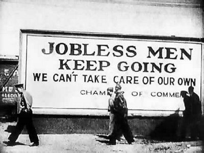 This photo from the Great Depression shows that many able and qualified men couldn't even get a job if they wanted to. The sign lets them know that no jobs are available there.: